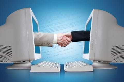 Picture of two hands coming out of a computer